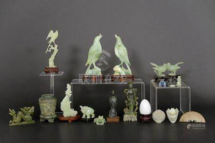 several Chinese sculptures in jade