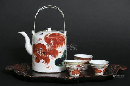 Chinese teaset with teapot and 7 cups on a tray