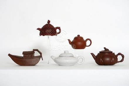 """five Chinese teapots in marked """"Yixing"""" earthenware"""