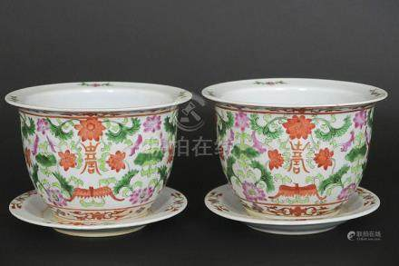 pair of Chinese jardiniers with their dish in porcelain