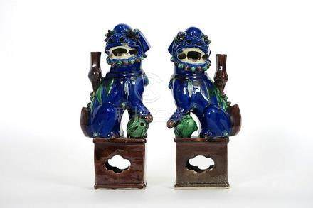 pair of antique Chinese temple lions in porcelain