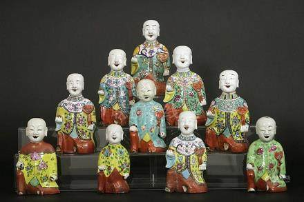"ten 18th/19th Cent. Chinese ""laughing boys"" in porcelain wit"