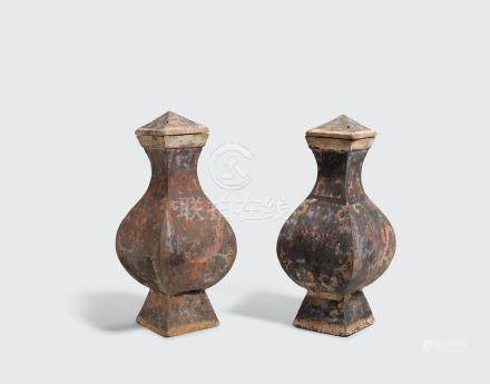 A PAIR OF SQUARE-SECTIONED PAINTED GRAY POTTERY JARS AND COVERS Han dynasty