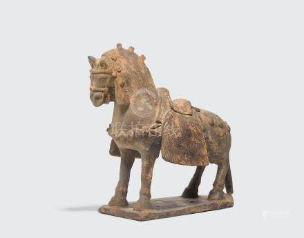 AN ELABORATELY CAPARISONED GRAY POTTERY HORSE Northern Wei dynasty