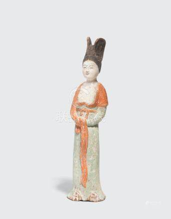 A PAINTED POTTERY FIGURE OF A COURT LADY Tang Dynasty