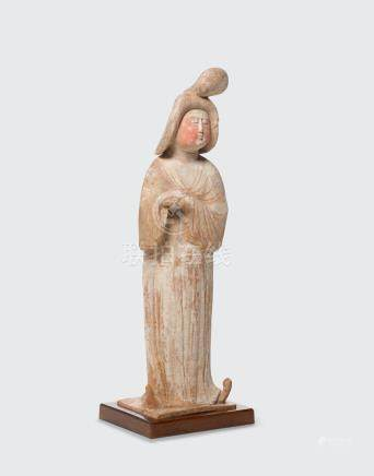 A PAINTED POTTERY STANDING FIGURE OF A FAT LADY Tang dynasty
