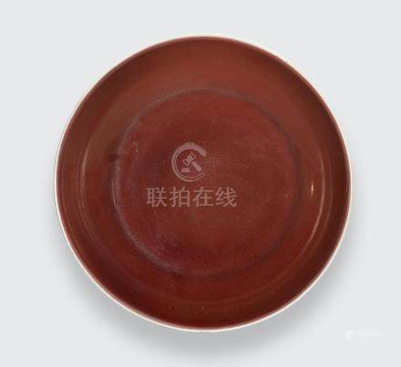 A copper red glazed deep dish Qianlong six-character mark and of the period