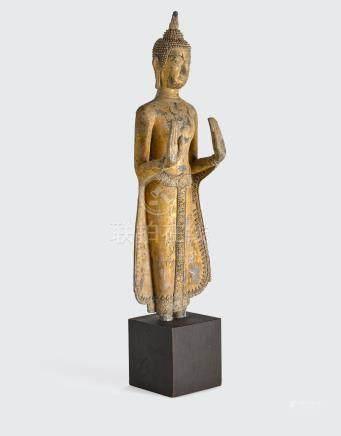 A Thai Rattanakosin style gilt lacquered metal figure of Buddha