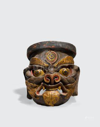 A polychrome papier-mâché ritual mask of a wrathful deity