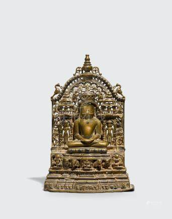 A SILVER INLAID BRASS ALLOY JAIN SHRINE Western India, dated by inscription to Samvat 1637/1580CE