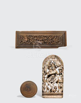 A group of three Indian carved wood plaques