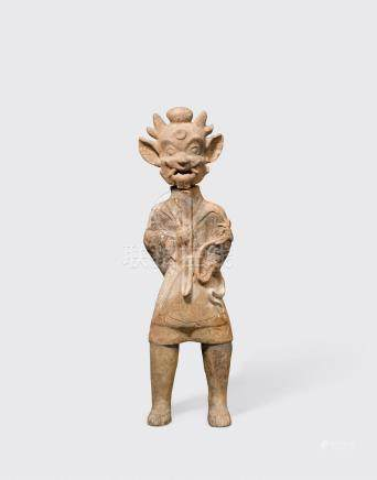 A standing grey pottery figure of a tomb guardian, zhenmuyong Eastern Han dynasty (25-220 CE)