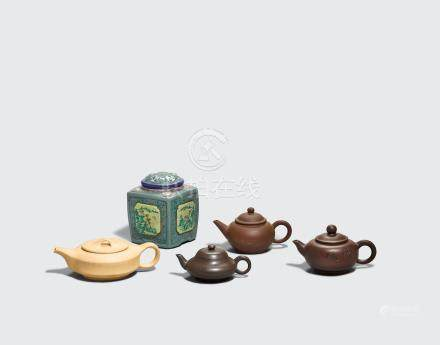 A group of four small yixing teapots