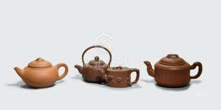 A group of four incised and molded Yixing teapots