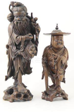Chinese carved wooden figure of a fruit merchant, circa 1900,