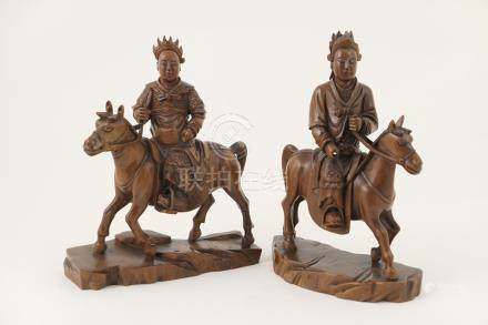 Pair of Chinese carved wooden equestrian figures,