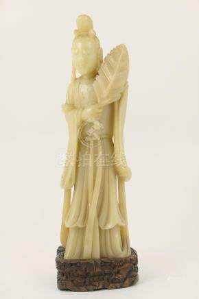 Chinese carved soapstone figure of Guanyin, presented on a carved wooden stand,