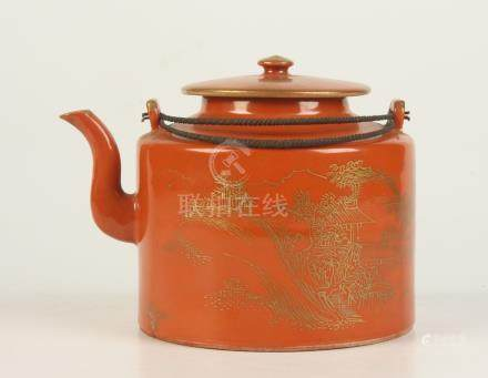 A Chinese coral ground porcelain teapot, 19th century, gilt decorated with a river scene,
