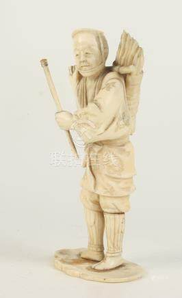 A Japanese ivory sectional okimono of a worker, 19th century, signed to the base, height 15cm,