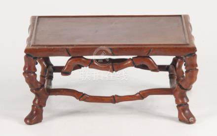A Chinese huali wood stand, with cabriole legs joined by stretchers, height 8cm, width16.