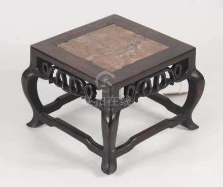 A Chinese huali wood stand, early 20th century, with square marble inset top,