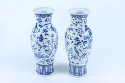 A pair of Chinese porcelain vases, late 19th century, each decorated with birds amongst foliage,