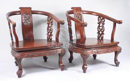A pair of Chinese huali wood tub armchairs, each with a central vertical carved splat,
