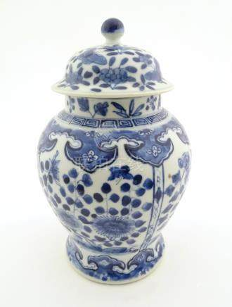 A Chinese blue and white ginger jar with panelled floral and butterfly decoration,