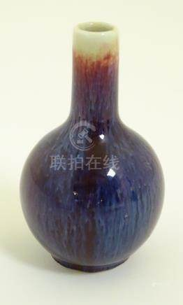 "A Chinese sang-de-boeuf, high fired porcelain, small proportion bottle vase. Height: approx. 4""."