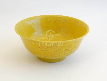 A Chinese Imperial yellow glazed, incised dragon bowl , decorated with 5 clawed dragon and phoenix ,