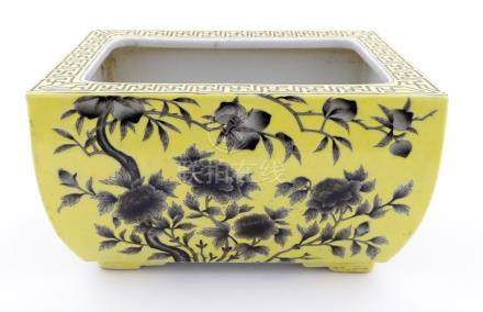 A Chinese yellow oblong planter decorated with black cherry blossom and peonies,