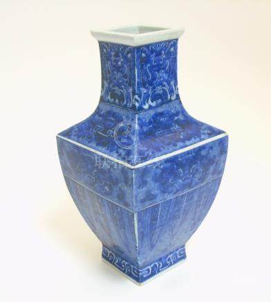 A Chinese blue and white square section vase, with archaic style decoration ,
