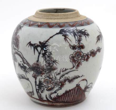 A Chinese red, black and white vase decorated with cherry blossom and bamboo on a rocky outcrop,
