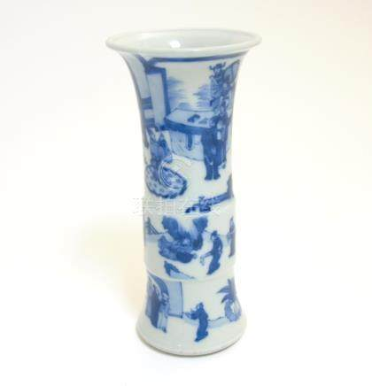 A Chinese blue and white Gu vase with underglaze blue decoration depicting imperials in a pagoda