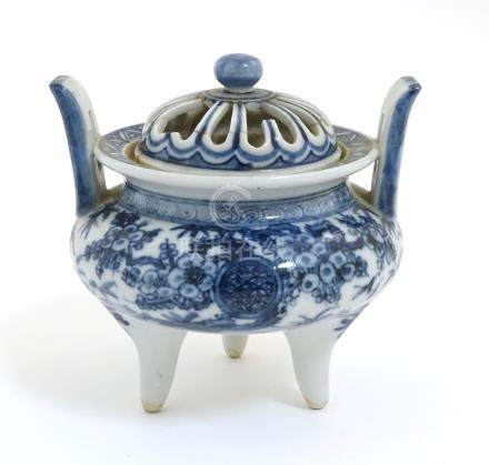 A Chinese blue and white three legged, two handled censer with pierced cover,