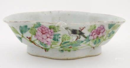 An oriental quatrefoil/lozenge shaped dish with hand painted decoration to include Chinese