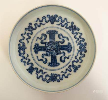 A Chinese blue and white dish on small pedestal base, decorated with the symbols of the 8 immortals,