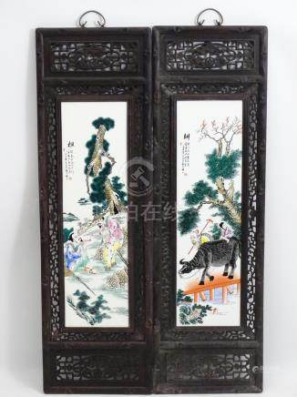 A pair of Chinese hardwood screens each with openwork decoration and an inlaid Chinese ceramic