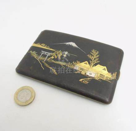 An early 20thC Japanese Amita hip formed cigarette case with damascene style decoration depicting