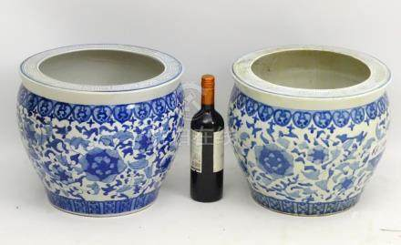 A pair of Chinese blue and white ceramic planters,