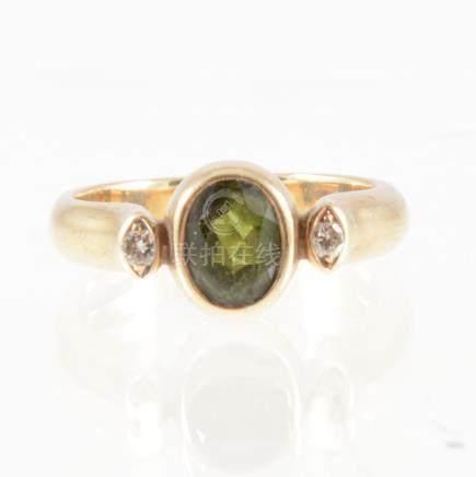 Tom Payne - A tourmaline and diamond three stone ring,