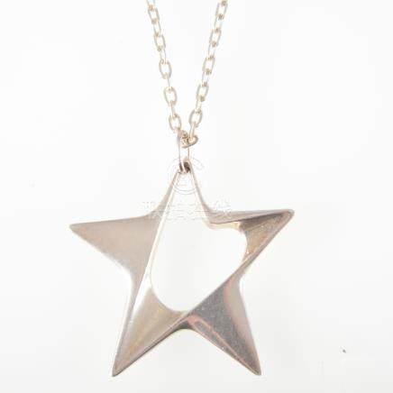 Henning Koppel for Georg Jensen of Denmark - A silver star pendant number 147, 60mm diameter,