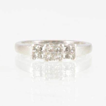 A Princess cut diamond ring,