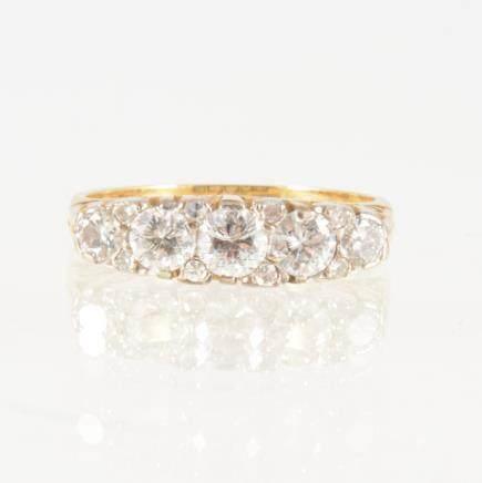 A diamond five stone half hoop ring,