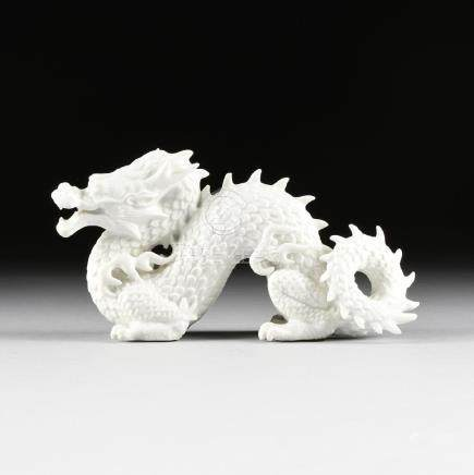 A CHINESE BLANC DE CHINE PORCELAIN FIGURE OF A DRAGON,