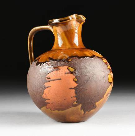 A ROYAL HAEGER LAVA GLAZE CERAMIC PITCHER FROM THE