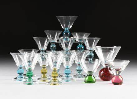 A GROUP OF EIGHTEEN CLEAR AND COLORED CRYSTAL STEMS,