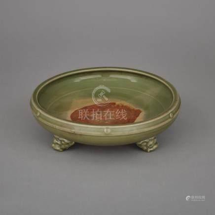 A Longquan Celadon Tripod Censer, Ming Dynasty, 明 龍泉窯青釉三足刻花紋大盤, diameter 13 in — 33 cm