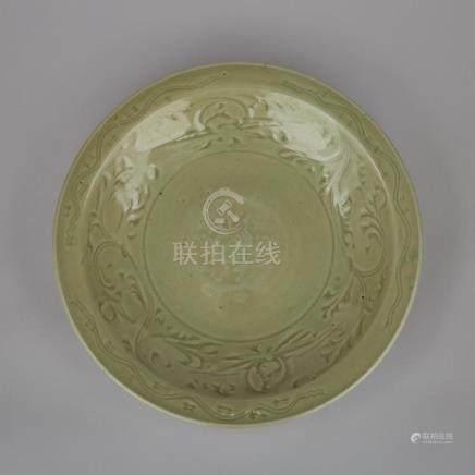 A Longquan Celadon Charger, Ming Dynasty, 明 龍泉窯青釉刻花纏枝蓮紋盤, diameter 13.6 in — 34.5 cm