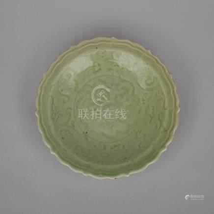 A Longquan Barbed-Rim Dish, Ming Dynasty, 明 龍泉窯青釉折枝花卉紋棱口折沿大盤, diameter 9.6 in — 24.5 cm